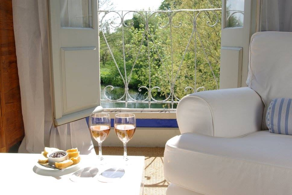 table with some snack and rose wine in a room at  La Bastide Rose hotel