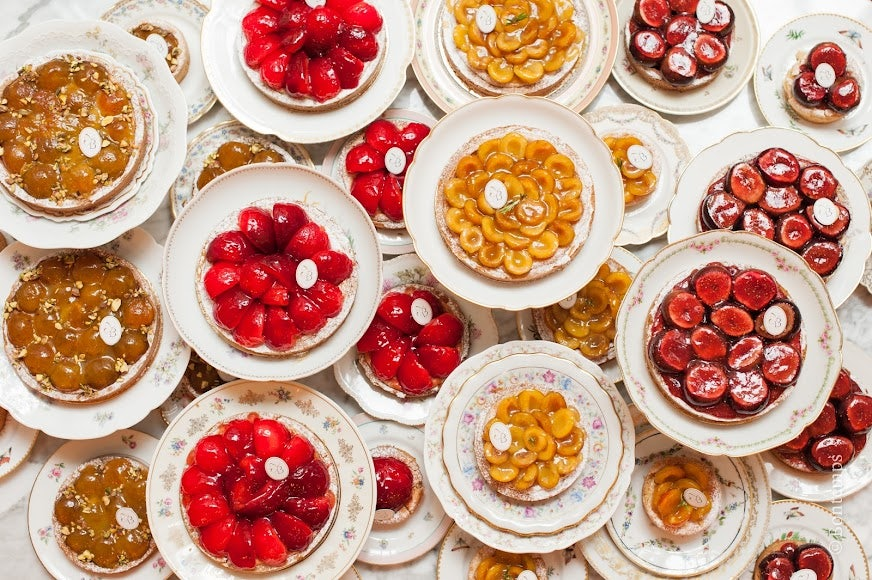a flatlay shot of different types of fruit cakes made by Parisien patisserie Bontemps